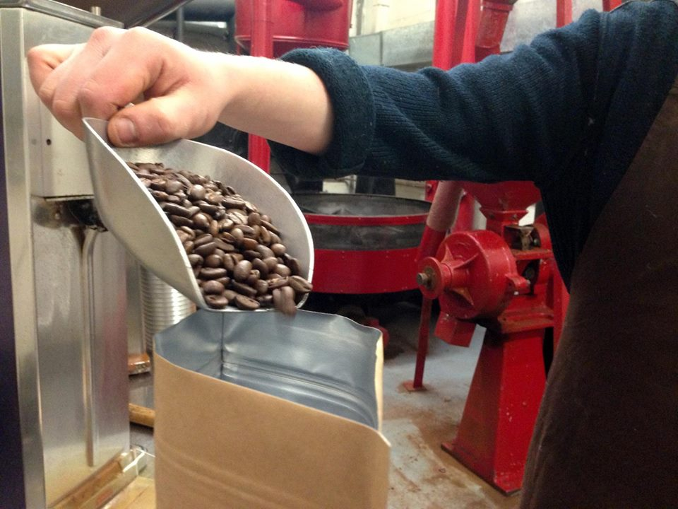 Coffee being bagged immediately after roasting