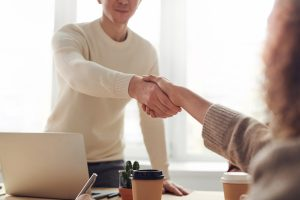 Closeup of shaking hands in a bright modern office