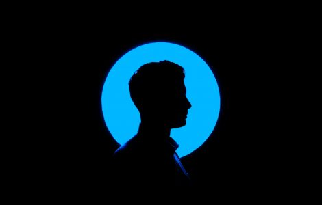 Silhouette of a profile against a blue a background