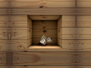 Close up of wooden niche in wall with casino dice