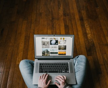 Overhead view of person sat on floor using laptop