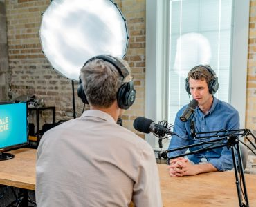 A man being interviewed by a radio host