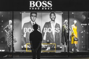 Person standing outside a Huge Boss shop