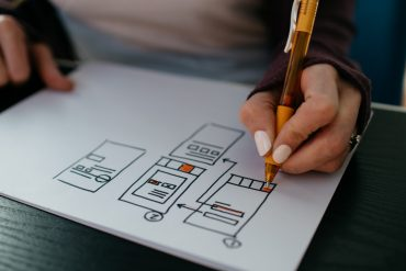 Closeup of someone drawing up a website wireframe