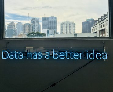 Blue neon lettering spelling out 'data has a better idea'