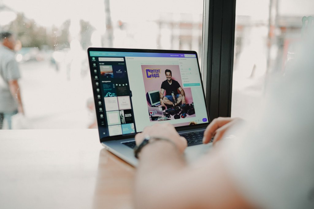 Person creating visual content on a laptop