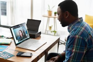 Man having a video call with a woman
