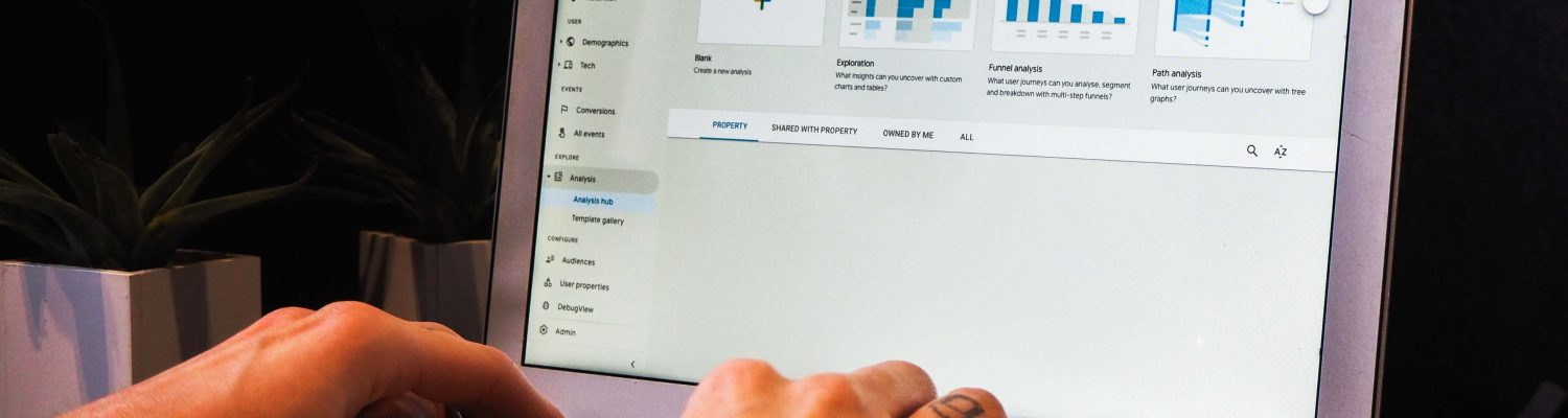 Image of a man looking at analytics on a laptop - What does SEO content writing mean - Copify blog 2