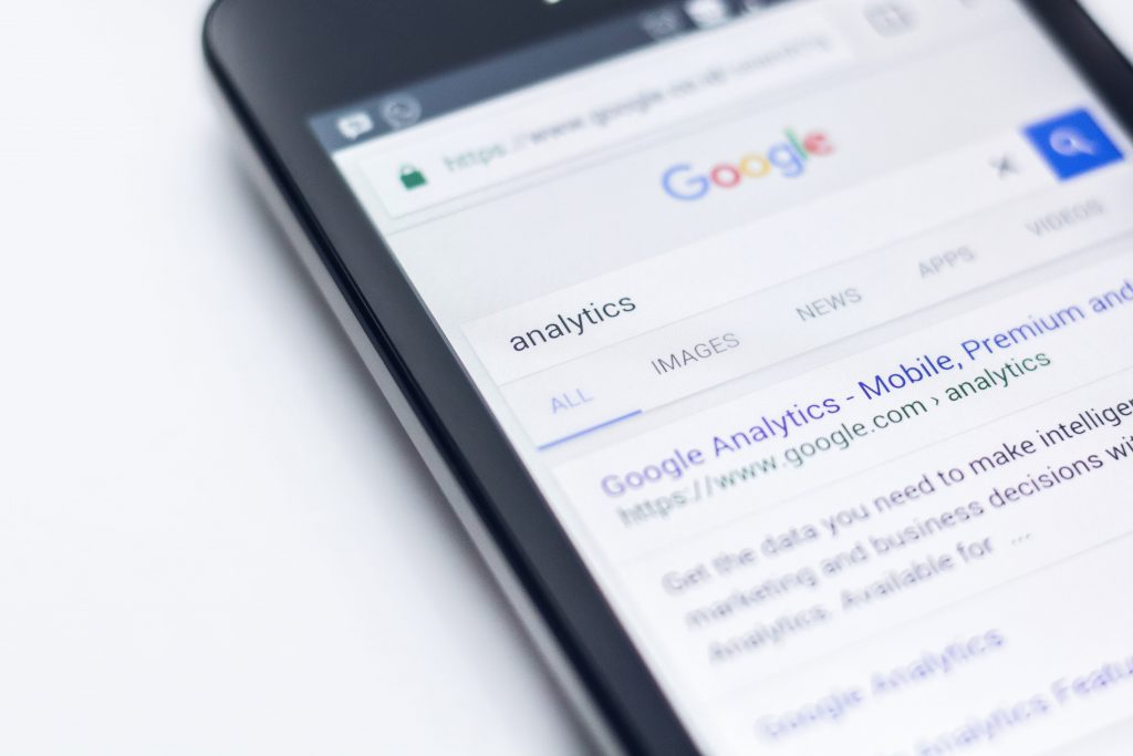 Image of a smartphone with Google results pages - What does SEO content writing mean - Copify blog