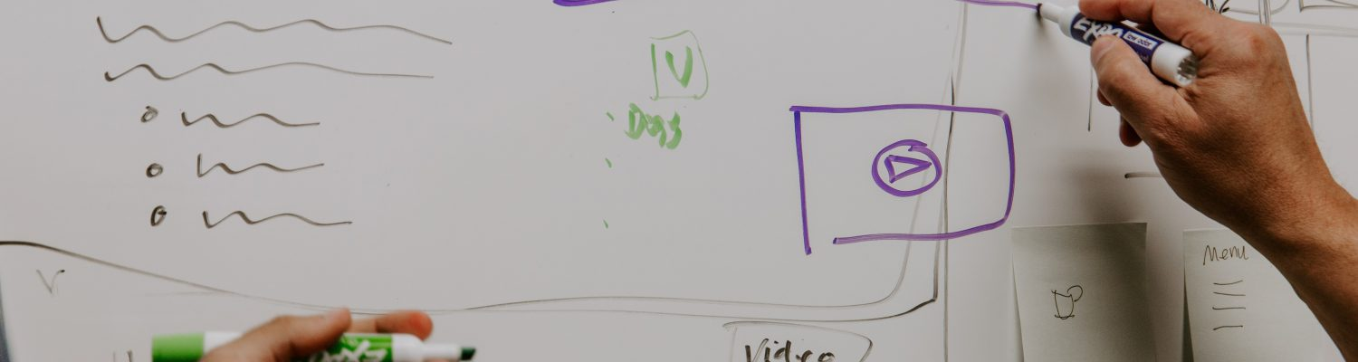 Whiteboard showing a marketing funnel and strategy