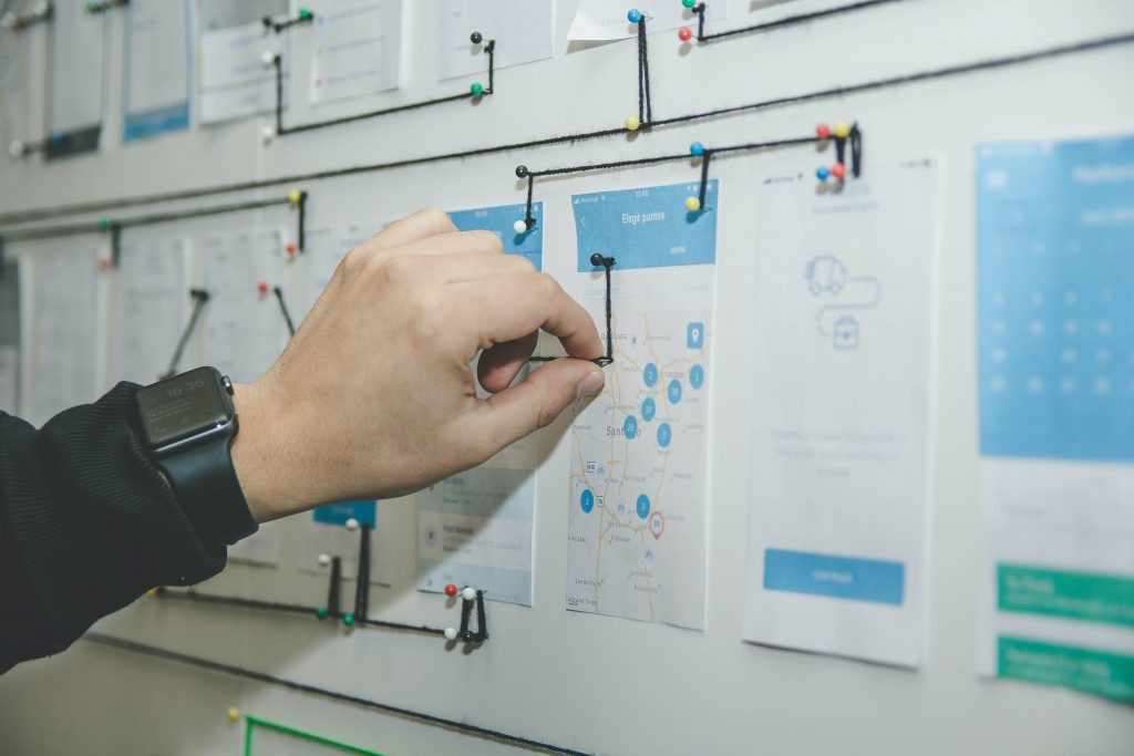 Image of a hand pinning notes to a board -How to create an effective Google SEO content strategy - Copify blog