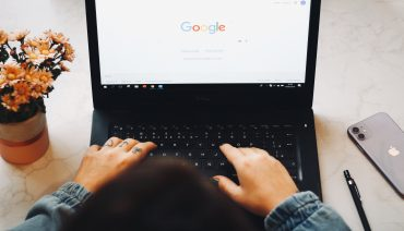 Overhead photo of someone using Google - How to perform an SEO content audit - Copify blog