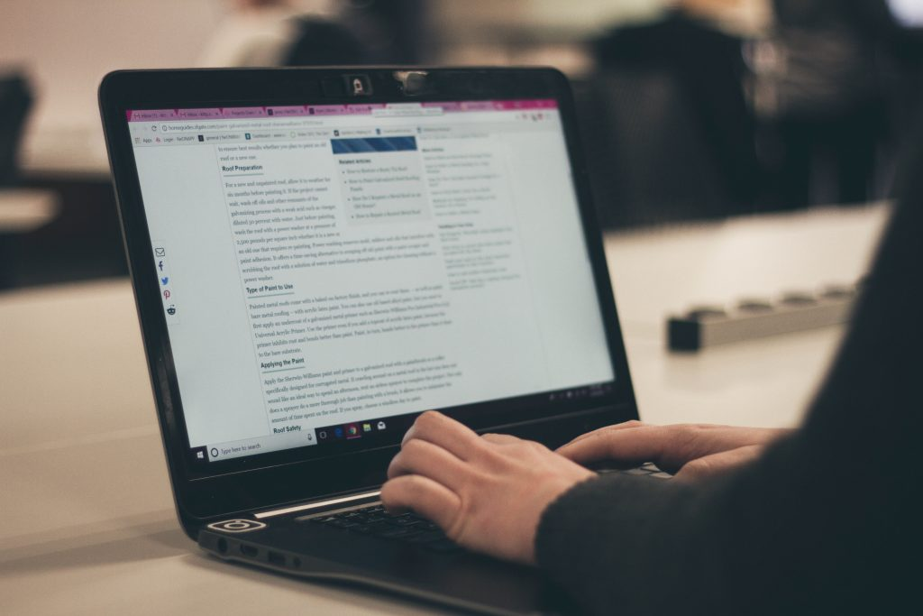 Closeup photo of someone typing web page copy - How to perform an SEO content audit - Copify blog