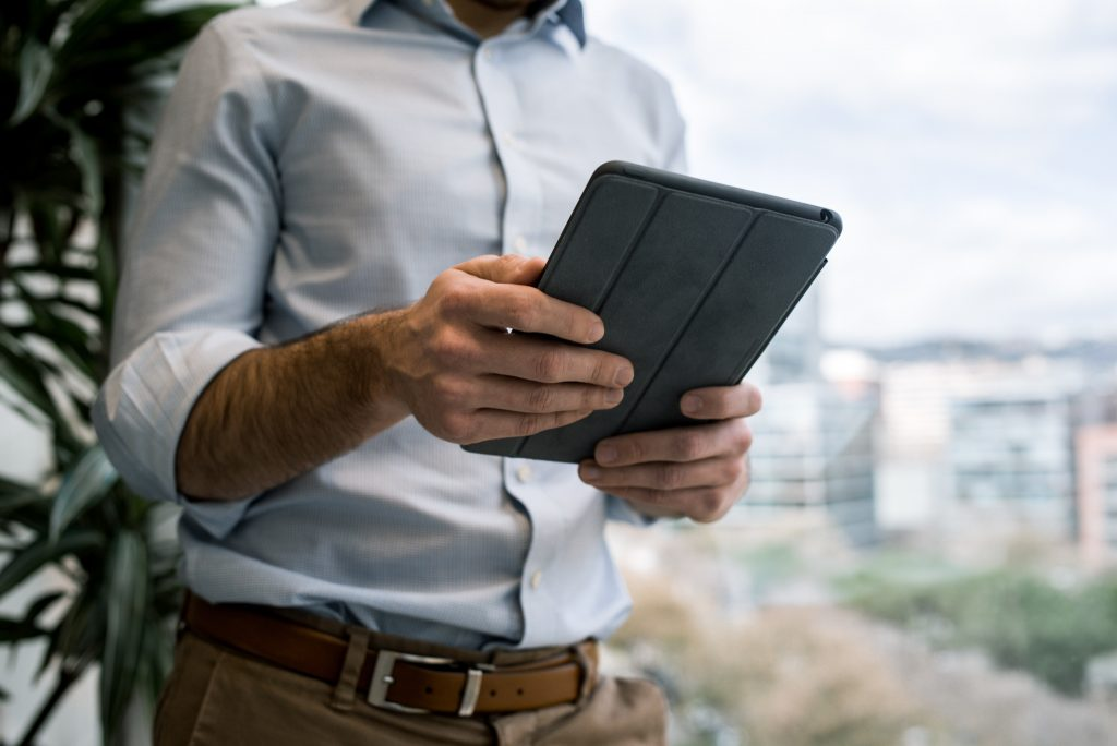 Image of man browsing on tablet - How to update website content online - Copify blog