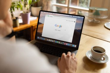 Man searching Google on his laptop - How to write SEO optimised content - Copify blog