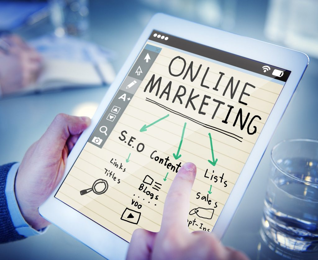online marketing plan on iPad with arrows to SEO, content, lists