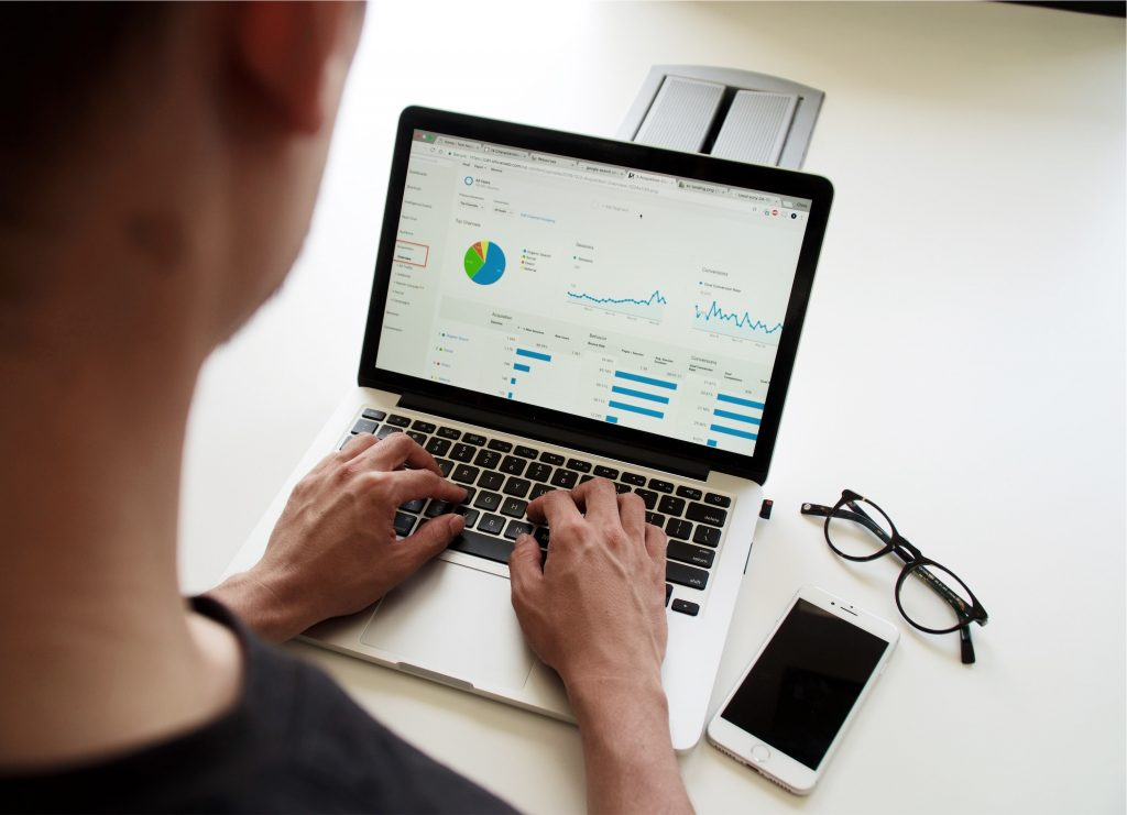 Image of someone looking at stats on a laptop -How does brand awareness impact sales - Copify blog 1