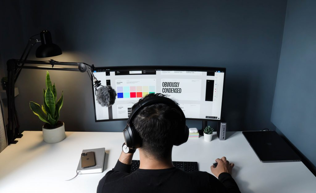 Image of a person designing a computer - How does brand awareness impact sales - Copify blog