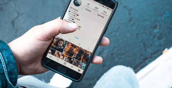 Image of a mobile screen showing social media profile - How does social media support content marketing - Copify blog