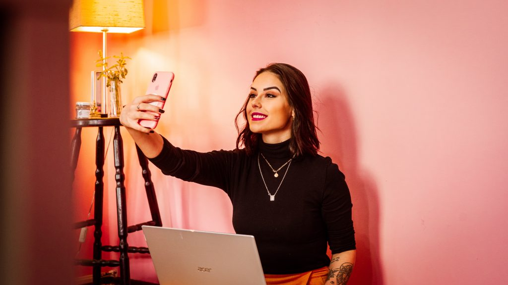 Image of a female influencer videoing herself - How to market my ecommerce store - Copify blog