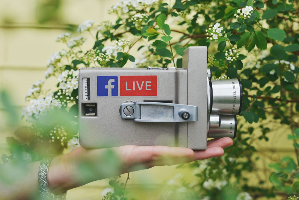 Image of someone holding a Facebook Live cam - How to market my ecommerce store - Copify blog