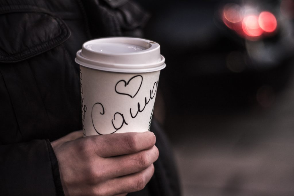 Image of someone holding a coffee mug with a name written on - What is lead generation in email marketing - Copify blog