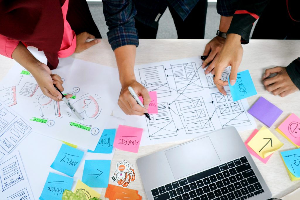 Image of a group of people strategising - What is the connection between SEO and content marketig - Copify blog 1