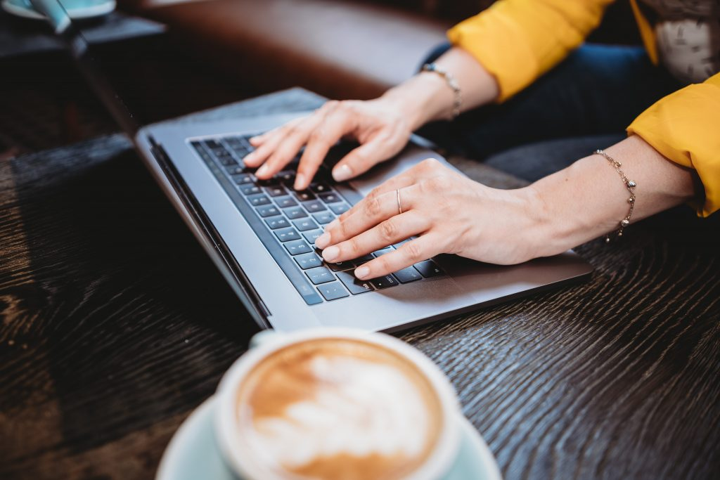 Image of someone typing on a keyboard - What is the connection between SEO and content marketing - Copify blog
