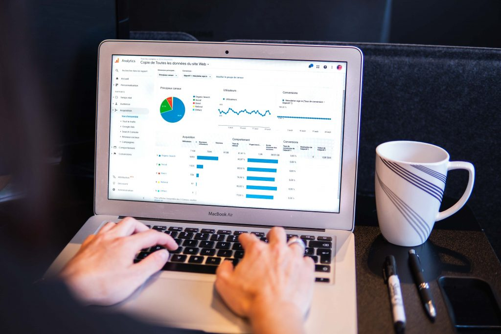 Image of graphs on a laptop - how big is the content marketing industry - Copify blog