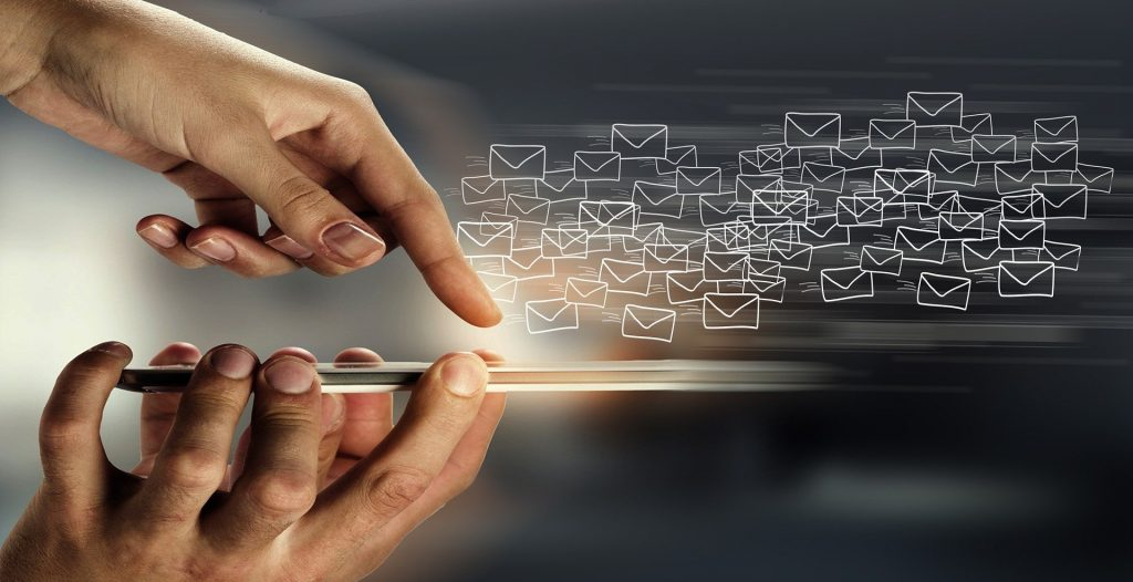 Image of a finger swiping over a smartphone with email i cons - What does lead generation mean in marketing - Copify blog