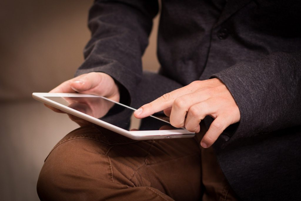 Image of a man using a tablet -What does lead generation mean in marketing - Copify blog